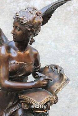 Grand bronze signé Mathurin Moreau livre d'or et sa colonne en marbre XIX